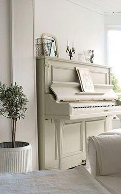 Ivory white painted piano