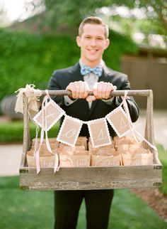 Toss: Bird Seed.  Or could use the same concept for party favors/goodie bags.  Cute.