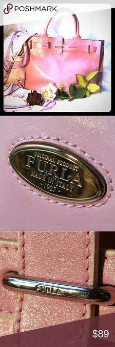 Furla 👜 Leather Handbag 👜 Made in Italy Authentic pink genuine leather Furla handbag. Made in Italy. Interior zip pocket and cell phone pouch. Approximately 14.5 x 5.5 x 12 inches. Used condition. Examples of exterior & interior wear in photos. Priced accordingly. Furla Bags Satchels