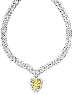 Magnificent Platinum, 18 Karat Gold, Fancy Intense Yellow Diamond and Diamond Pendant-Necklace, Van Cleef & Arpels, New York, 1978   lot   Sotheby's