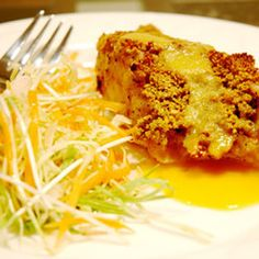 Seafood, Macadamia Crusted Sea Bass With Mango Cream Sauce, Sea Bass, Seared With Garlic, Then Topped With A Macadamia Nut Crust And Baked Until Golden. Accompanying This Delectable Treat Is A Mango Cream Sauce.