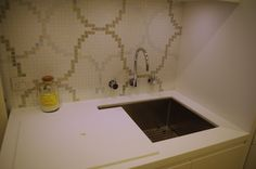 Laundry with Corian benchtop and cover to sink for extra bench space