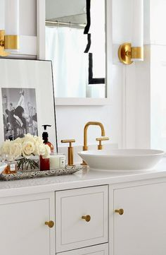 Bathroom, gold accents.
