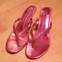 Pink heels Pink 2 1/2 inch heel. Size 6 1/2. There is a little scratch on the back of the heel not visible when wearing them, shown in picture. Looks great with jeans and dresses! Perfect pop of color. Shoes Heels