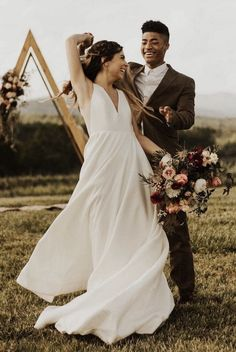 This taffeta gown features a deep v-neckline and a strappy open back accented with angular illusion panels.The full A-line skirt extends into a sweeping train. Most Beautiful Wedding Dresses, Beautiful Bridesmaid Dresses, Bhldn Wedding, Chic Wedding, Fall Wedding, Bridal Outfits, Bridal Gowns, Bridal Musings, Wedding Dress Shopping