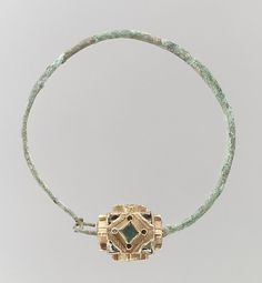 Earring Date: 6th–7th century Culture: Frankish Medium: Gold, green and clear glass, pearls(?); hoop copper alloy or base silver Dimensions: Overall: 2 5/8 x 2 3/8 x 5/8 in. (6.6 x 6 x 1.6 cm) bead: 5/8 x 11/16 in. (1.6 x 1.8 cm)