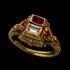Gold gimmel ring, enamelled in various colours , the raised double box bezel containing a table cut diamond and red enamel simulating a ruby, opening to reveal two cavities beneath, filled respectively with a newborn baby and a skeleton, The inner sides of the twin interlocking hoops which are inscribed in Latin NON SEPARET HOMO /QUOD DEUS CONIUNXIT.( Man must not divide those whom God has joined together) terminate in winged shoulders and hands gripping red hearts...16th/early 17th century