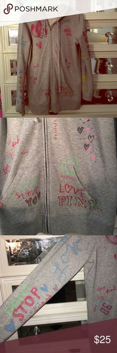 "Super cute VS zip-up hoodie This has been one of my most loved VS zipper hoodies! It is a heathered gray color with a ton of little 💕 & notes. I've only seen one other of this hoodie and the seller referred to it as ""rare"" with a very high price tag💎. Mine is used and has some paint on the sleeves (since I'm an artist👩🏼‍🎨)The price reflects that. If I get it off I will update this listing, the photos, and the price. 🤷🏼‍♀️ PINK Victoria's Secret Tops Sweatshirts & Hoodies"