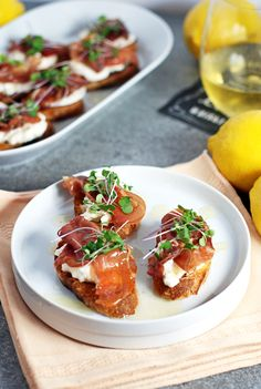 These quick prosciutto crostini feature crispy prosciutto, creamy burrata, and a simple lemon honey drizzle sauce that is sure to be a hit with your guests!