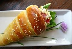 Use crescent rolls and shape into cones and fill with chicken, tuna, or egg salad.