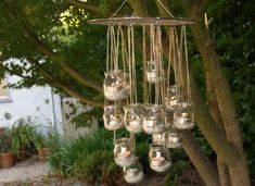 DIY candel chandelier: all you need are some small glass jars, S hooks, a cooling rack, beaded chain and wire.   - created by Michelle Kaufmann
