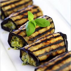 Eggplant with ricotta pesto filling, a perfect side dish! Serve with grilled chicken for an easy dinner.