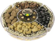 Send the perfect anniversary gift with our lovely Lucite tray full of cuts, chocolates and candies.