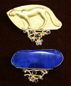 Linda Kindler Priest  ||  Twilight Run, Cheetah brooch in two parts  ||  Top: 14k repoussee, 97pt blue sapphires. Bottom: 14K 53pt blue sapphires, lapis, oxidized silver $3,900