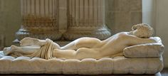 """Sleeping Hermaphroditos"" Roman copy (2nd Century AD). Mattress by Gianlorenzo Bernini (1619). Mesmerizingly supple-looking, this sculpture is a life size copy of a bronze Hellenistic sculpture. In the 17 brilliant artist Bernini made the cushion so realistic that people are tempted to test its firmness. What is special about this beautiful woman? Click to the next slide or investigate in person."""