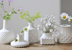 """Hand made vases, inspired by the textures of cut glass of crystal decanters, these little vases add instant understated charm to any setting. Shan's signature rugged seam lines, contrast with the smooth surfaces and intricate textural patterns in these """"must have"""", playful little vessels"""