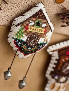 Cuckoo clock cross stitch ornament.