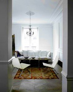 I love Kilim rugs! Especially paired with modern white furniture.