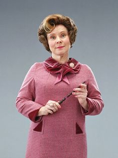 Day 4. Least Favorite Female Character. Definitely Umbridge by a mile. I kinda wish JK would have killed her off, I hate her so much. She's worse than Bellatrix, who straight-up murdered Sirius. That's saying something from me. BTW, she's tacky, and I hate her. XD