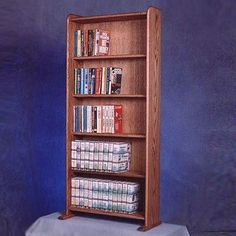 Features:  -Holds 275 CD's or 200 DVD's.  Product Type: -Storage rack.  Material: -Wood.  Media Storage Type: -CD storage/DVD/Blue Ray storage.  CD Capacity: -275.  DVD Capacity: -200.  Wall Mountable