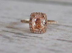 peach champagne sapphire dimond ring (I don't think i'd want a gold wedding ring but this is just so pretty)