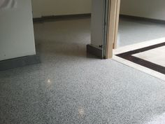 Lake Ozark mo Decorative Concrete Flooring Overlay, Osage Beach mo, sunrise beach Missouri, 3 car Garage floor at Osage National Golf Course in Lake Ozark, mo has Epoxy and Vinyl Chips to make it give the appearance of Granite, its a Showroom floor!