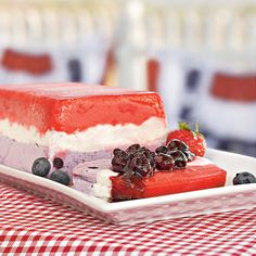 Red, White, and Blue Delight.  Served with homemade blueberry sauce and fresh fruit.  #treat #dessert #fruit