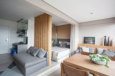 The modern living and sleeping areas of this small apartment open up to an integrated balcony that has a living area, dining area and laundry space. Small Apartment Interior, Small Apartment Design, Small Apartment Decorating, Small Space Living, Small Spaces, Japanese Interior Design, Tiny Apartments, Space Interiors, Living Room Designs
