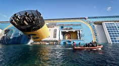 shipwrecks | PHOTO: The cruise ship Costa Concordia lies stricken off the shore of ...