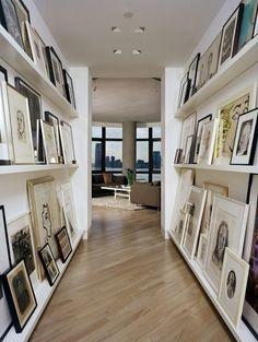 Gallery wall lining hallways