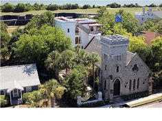 A romantic and whimsical fortified home on the quiet, western end of Sullivan's Island, Mugdock Castle is an iconic Charleston landmark steeped in history and charm. Comprised of the Gothic-style Winter Hall (c. 1891) and the Romanesque Summer Hall (c. 2009), the two buildings are joined by a central stair tower to form a genuine area's Lowcountry beach castle.