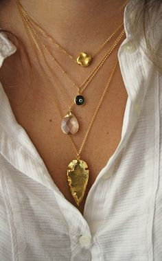 Layered necklaces dresses up any basic shirt and adds flair to an outfit in need.