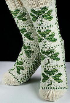 Ravelry: Shamrock Socks pattern by Christina Rowell  Also very cute!