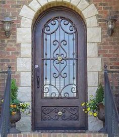 do not like wrought iron design too fem...but like idea of Single wrought iron front door.
