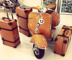 There's traveling and then there's Vespa traveling, complete with color-matched luggage. Of course, you're probably only going from one side of town to the other, but still...style is important...