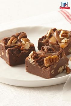 A gooey caramel layer sits atop this creamy chocolate fudge recipe. It's so easy that you can make multiple batches for holiday gift-giving or a Thanksgiving dessert.