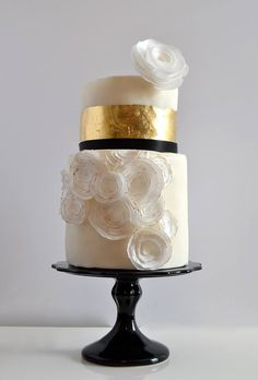 White, gold and black wedding cake