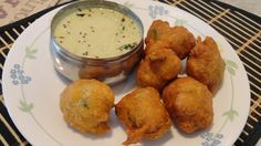 Mysore bonda also known as ulundu bonda is a popular fried snack from the mysore cuisine. these are round fritters made from urad dal/black gram. It can be at Break Fast time or Evening Tiffin time. Its easy to prepare and goes well with Coconut Chutney or Groundnut Chutney.