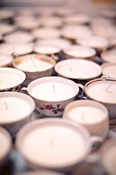 Tea cup + melted candle wax, add a wick!  I can't believe I didn't have this idea :)