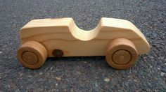 This Race Car has pine wood body and hardwood wheels.
