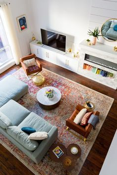 Bright floor & couches, plain wall