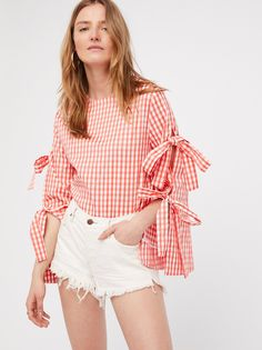 Gingham Top With Sleeve Detail | Bright gingham top featuring tie details along the vented sleeves for an ultra femme feel.    * Hidden back zipper closure