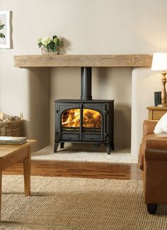 Wood Burner Fireplace, Cosy Fireplace, Wood Burning Fireplace Inserts, Fireplace Design, Wood Stove Surround, Wood Stove Hearth, Cosy Cottage Living Room, Log Burner Living Room, Modern Stoves