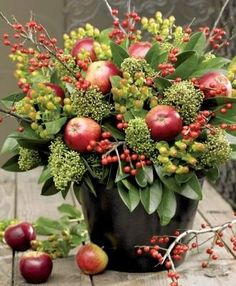 Apples, Berries and magnolia Christmas arrangement