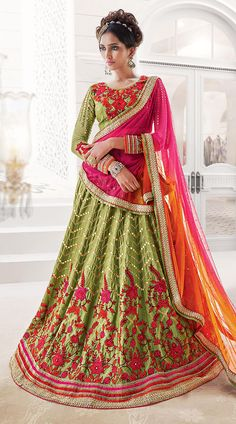 Precious Green Banglori Silk Mirror Work Navratri Chaniya Choli JS200550 This banglori silk lehenga choli in fashionable green color with dupatta which is decorated with embroidery work. It has heavy work of stone, zari, resham, embroidery and lace in the skirt part which is increasing its attractiveness. This unstitched choli can be stitched in the maximum bust size of 42 inches.