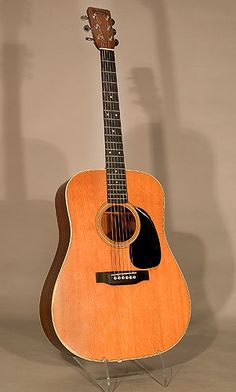 """Johnny Cash's guitar """"The Bon Aqua"""" was named after his Bon Aqua, Tn farm."""