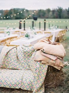 Southern wedding reception // hay bale couches + quilts + cafe lights