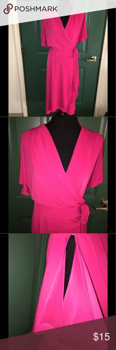 NWT Vicky Tiel Pink Wrap Dress 3X New with tags!  Wrap style dress. Pink.  Has short sleeves with slits down the center of the sleeves.  From Vicky Tiel.  Size 3X.  Dress is 42 inches long.   Important:   All items are freshly laundered as applicable prior to shipping (new items and shoes excluded).  Not all my items are from pet/smoke free homes.  Price is reduced to reflect this!   Thank you for looking! Vicky Tiel Dresses Midi