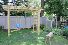 Grape arbor swing set!  I like this because swing sets are only useful for about 5 years.  By the time a new vine was big enough to fill it, the kid would be grown and you could convert it to a porch swing.