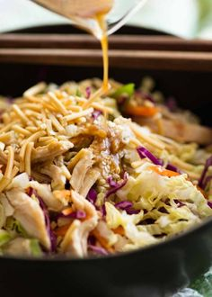 Asian Dressing being poured over Chinese Chicken Salad salad salad salad recipes grillen rezepte zum grillen Salad Recipes Video, Chicken Salad Recipes, Salad Chicken, Chinese Food Recipes Chicken, Chinese Chicken Salad Dressing, Asian Cabbage Salad, Healthy Chinese Recipes, Lunch Snacks, Col China